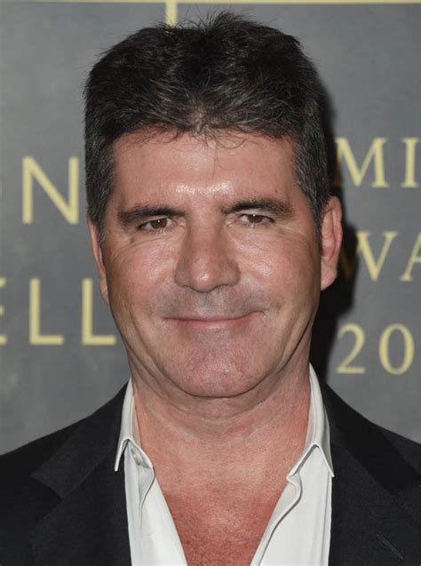 Offers 100000 To Simon Cowell louis walsh back to save x factor simon cowell s offer to
