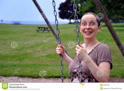 swing woman woman on swing with surprise expression royalty free stock