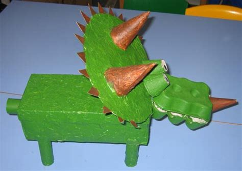 How To Make A 3d Dinosaur Out Of Paper - a colourful triceratops model made from an egg box and a