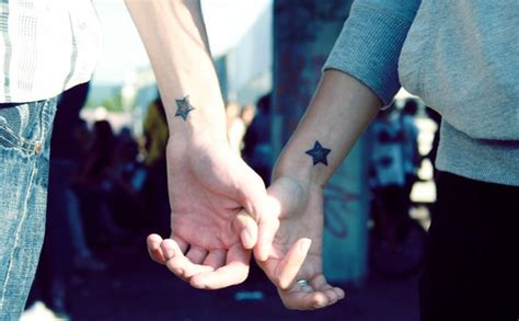 star tattoo for couples connecting tattoos for couples