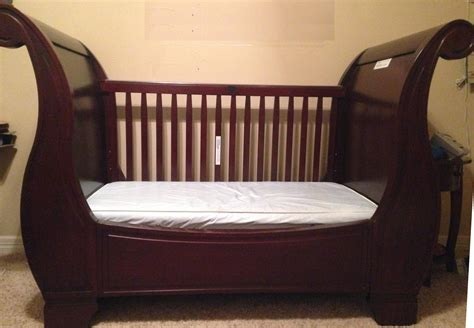 Sleigh Bed Baby Crib Bedroom Interesting Sleigh Crib Design With Beige Wall For Baby Nursery Decor