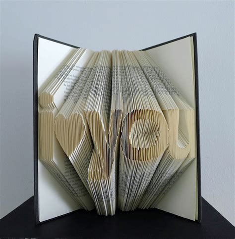 Folded Paper Book - complementing arts folded book sculptures by luciana