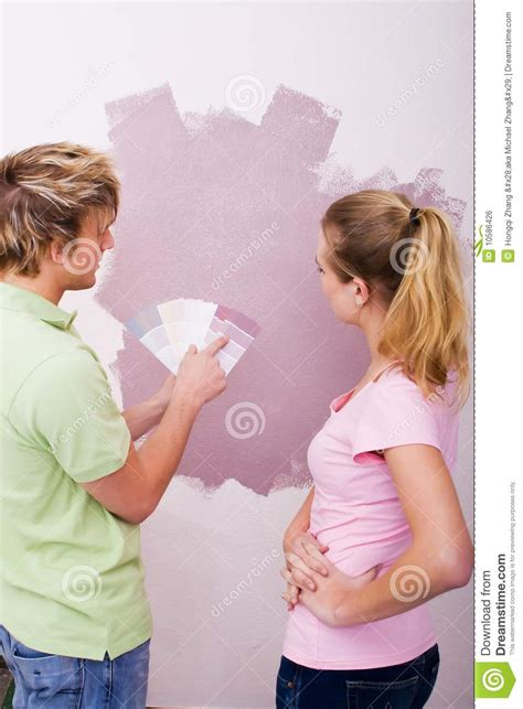 picking paint colors couple picking paint colors royalty free stock image