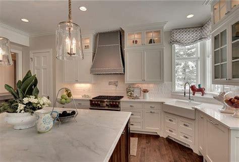 carrara marble kitchen island island countertop is honed carrara marble exteriors are quartz kitchen carrara