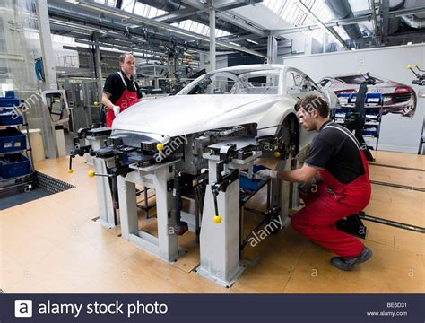 Audi Mitarbeiter by Audi Employees Assembling The Frame Of An Audi R8 Sports