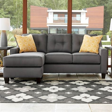 aldie nuvella gray sofa chaise benchcraft furniture faux leather sofa with tufted seat