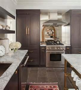 beautiful kitchen features brown stained cabinets