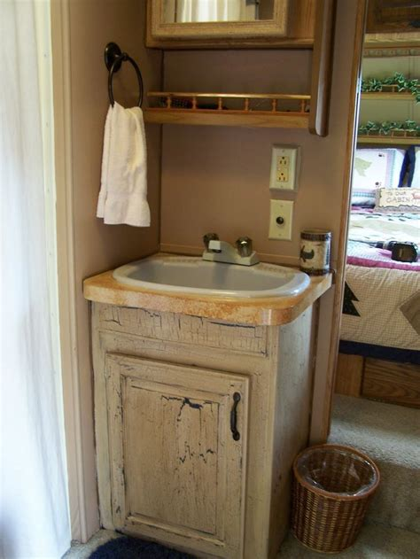 camper remodel painted bath cabinet  counter top