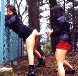 skirts bent over hairy 2girls bent over black hair brown hair enema enema