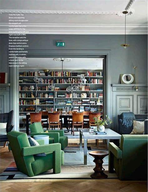 living room with library ett hem hotel stockholm sweden ilse travel scandinavia grey walls