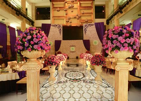 Mediterranean Style Wedding - wedding banquet hall decoration flowers and lamps interior design