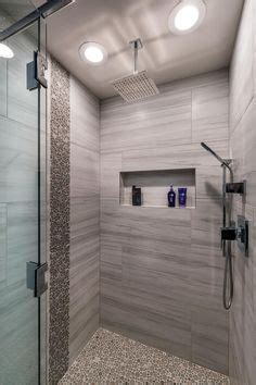 giving head in bathroom master shower with wood plank tile flat river rock deco