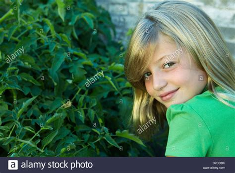 7 year old girl stock photo 7 year old girl looking over her shoulder stock photo