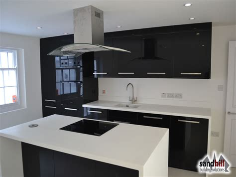 Black Gloss Kitchen With White Worktops by 016 High Gloss Black Kitchen White Worktop Jpg