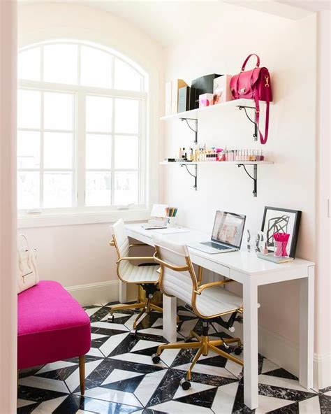 white and pink office with side by side desks