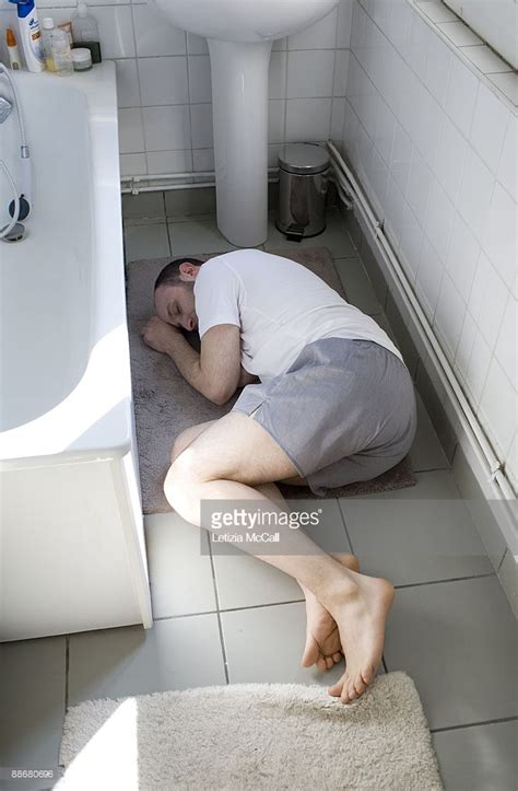 men in the bathroom man sleeping in the bathroom stock photo getty images