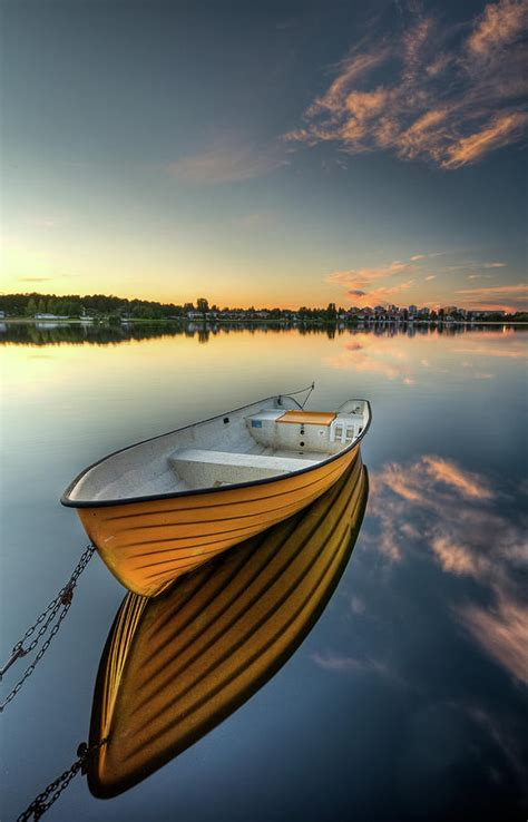 boat photography orange boat with strong reflection photograph by david olsson