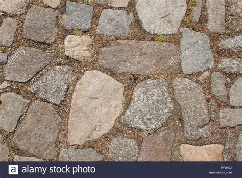 piastrelle in granito vecchia pavimentazione di pietra sulla strada dettaglio