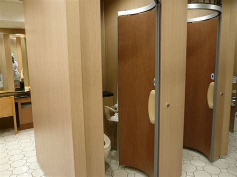 space saving doors beautiful space saving stall doors public restrooms