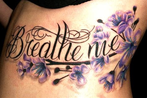Tattoo Lettering With Flowers | flower side lettering tattoo by bugaboo tattoo