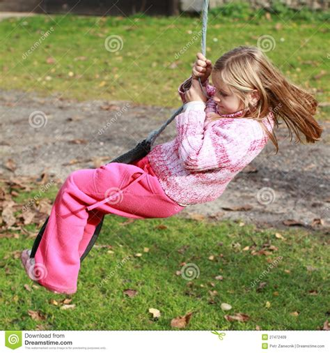 little girl swinging little girl on a swing royalty free stock images image