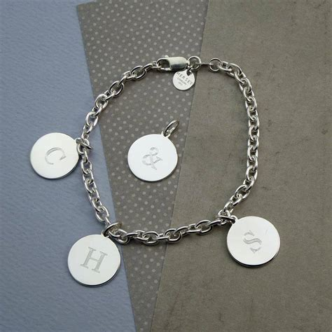 solid silver initial charm bracelet by hersey silversmiths