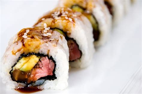 futon roll sushi beef roll sushi with seasoned black mushrooms sounds