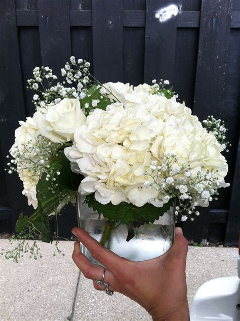 white hydrangea white rose and babysbreath centerpiece