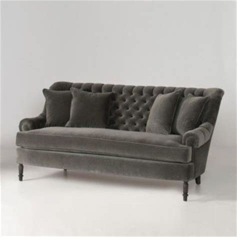 tufted grey velvet with matching pillows this is