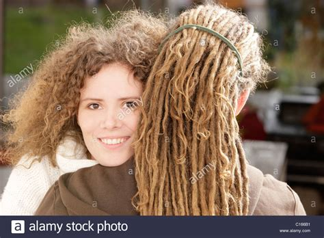 curly rasta hair woman curly rasta hair woman woman with curly hair smiling and a