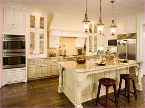 antique white kitchen with wood floors and an wood floors with oak cabinets home design ideas