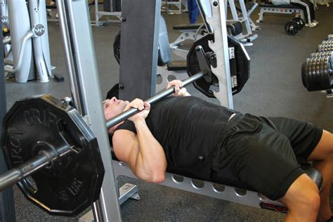 bench press with smith machine smith machine close grip bench press exercise guide and video