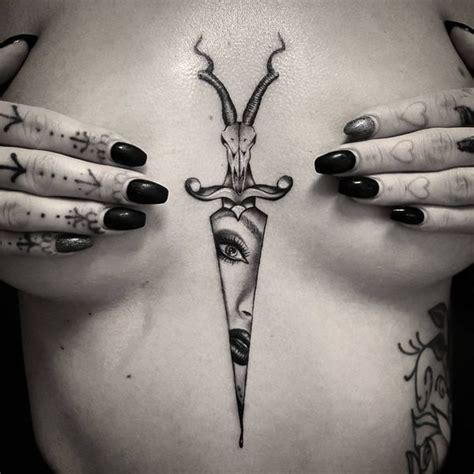 sternum tattoo between the breast tattoo design ideas