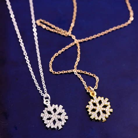 Rhinestone Snowflake Necklace gold and silver rhinestone snowflake necklace by j s