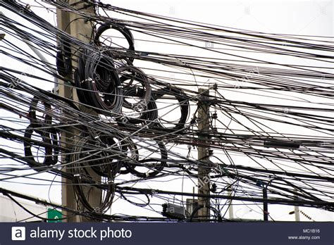 wires messy  power  cables transformers  phone lines   electricity pillar