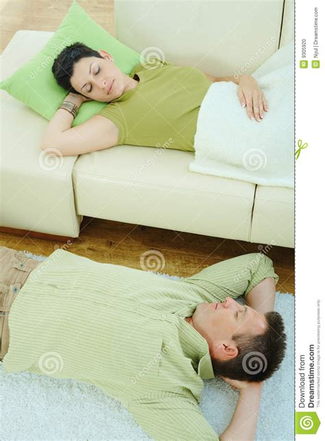 got a couple of couches sleep on the loveseat couple sleeping on couch stock photo image 9305920