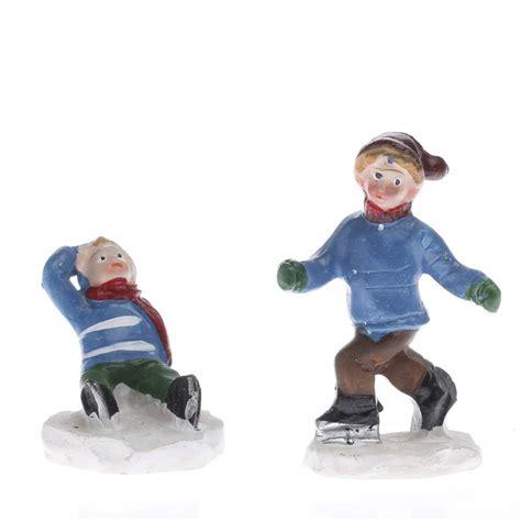 miniature ice skating children village figurines