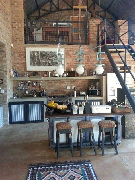 brick apartment with mezzanine i those stools and i d use more rugs but it has a cool vibe