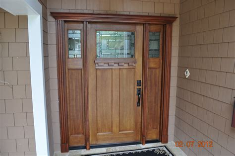 craftsman style fir grain fiberglass entry door with