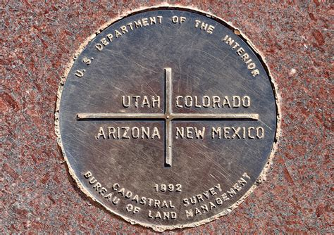 For Corners standing on four states at four corners monument the