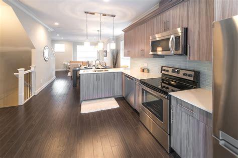 White Kitchen Cabinets With Dark Hardwood Floors Modern