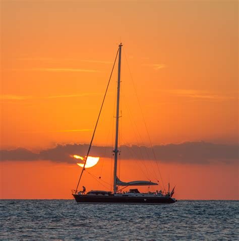 sailboat in sunset sailboat on body of water during sunset 183 free stock photo