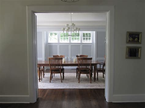 dining room with painted wood paneling traditional