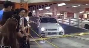 lowered cars and speed bumps motorist can t get out of hong kong car park because of