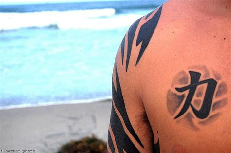 40 striking strength tattoos creativefan