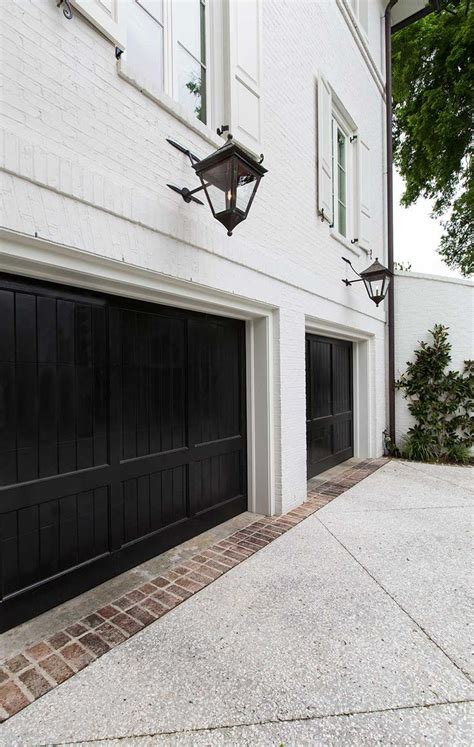 Double Black Garage Doors White Brick Uec Fixtures Black Garage Door