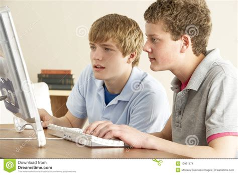 two boys on computer at home stock images image