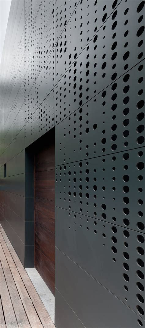 hole pattern in french perforated building facades that redefine traditional design