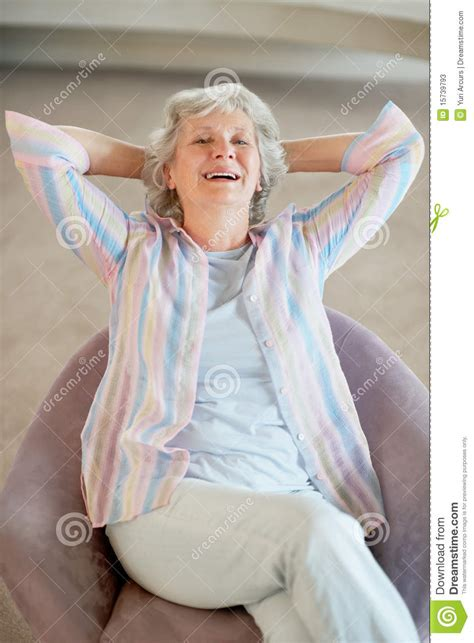 mature couch stock photos happy mature woman relaxing in couch image