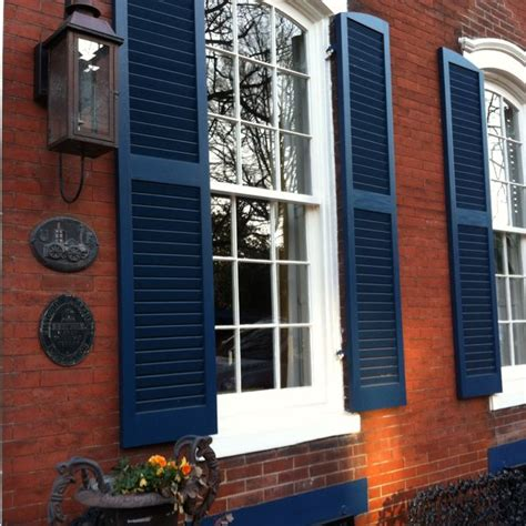shutters on brick house royal blue shutters on red brick for the home